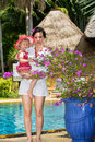 Cute little child girl with mother on pool in tropical resort Royalty Free Stock Photo