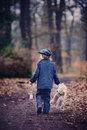 Cute little child holding lantern and teddy bear in forest preschool boy walking a dark Stock Image