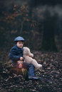 Cute little child holding lantern and teddy bear in forest preschool boy walking a dark Stock Images
