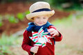 Cute little child holding toy windmill Royalty Free Stock Photo