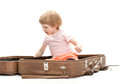 Cute little child inside a big suitcase Royalty Free Stock Photography