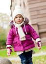 Cute little child in pink jacket and hat outdoor Royalty Free Stock Image
