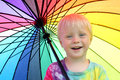 Cute Little Child Under Rainbow Colored Umbrella Royalty Free Stock Photo