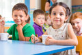 Cute little children drinking milk at daycare Stock Photo