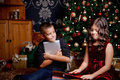 Cute little children opening a present Royalty Free Stock Photo