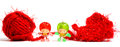 Cute little dolls and red wool ball Royalty Free Stock Photo