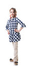 Cute little fashionista posing in checkered tunic isolated on white Royalty Free Stock Photos