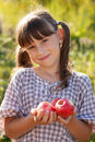 Cute little girl with apple in hand Royalty Free Stock Photos