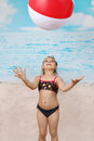 Cute little girl on beach with ball Royalty Free Stock Photo