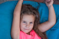 Cute little girl on bean bags, resting, portrait, long hair Royalty Free Stock Photo