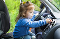 Cute little girl behind wheel Royalty Free Stock Photo