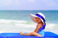 Cute little girl in big hat on summer beach Royalty Free Stock Photo