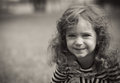 Cute little girl black and white portrait of in a park close up of beautiful child outdoors greyscale Royalty Free Stock Photos