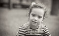 Cute little girl black and white portrait of in a park close up of beautiful child outdoors greyscale Royalty Free Stock Image