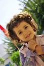 Cute little girl with blond curly hair Stock Image