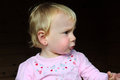 Cute little girl blond haired toddler pulls a face Stock Photo
