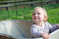 Cute little girl blond haired toddler sitting in a pushcart Stock Photo
