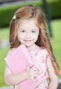 Cute little girl with book Royalty Free Stock Photo