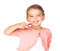 Cute little girl brushing her teeth against white Stock Photos