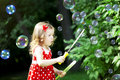 image photo : Cute little girl with bubbles