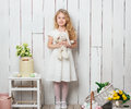 Cute little girl with a bunny rabbit toy on white wood background Royalty Free Stock Photo