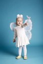 Cute little girl with butterfly costume on blue background Stock Images