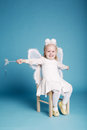 Cute little girl with butterfly costume on blue background Stock Photos