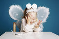 Cute little girl with butterfly costume on blue background Royalty Free Stock Photography
