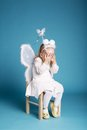 Cute little girl with butterfly costume on blue background Stock Photography