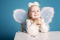 Cute little girl with butterfly costume on blue background Royalty Free Stock Photo