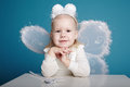 Cute little girl with butterfly costume on blue background Stock Image