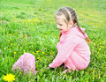 Cute little girl with butterfly net on the meadow Royalty Free Stock Photos