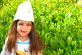 Cute little girl costumed with beautiful green background of plants Royalty Free Stock Image