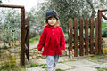 Cute little girl in a country near the house spring Stock Photos