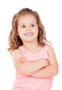 Cute little girl with crossed arms smiling on a white background Royalty Free Stock Photos
