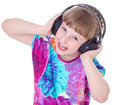 Cute little girl dancing kids kid child wearing a big black headphones isolated on white Stock Images