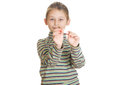 Cute little girl with a dart on white background isolated Royalty Free Stock Image
