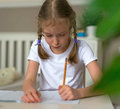 Cute little girl doing her homework. Royalty Free Stock Photo