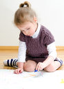 Cute little girl drawing Stock Photos