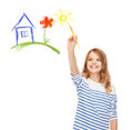 Cute little girl drawing house with brush education school and imaginary screen concept Stock Images