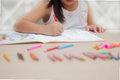 Cute little girl drawing picture on home interior background. Royalty Free Stock Photo