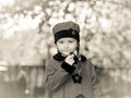 Cute little girl dressed in retro coat posing near oldtimer car Royalty Free Stock Photo