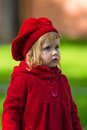 Cute little girl dressing in red coat Royalty Free Stock Images