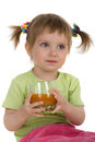 Cute little girl drink carrot juice Royalty Free Stock Photo
