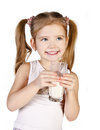 Cute little girl is drinking milk isolated Stock Images