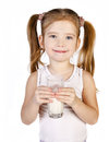 Cute little girl is drinking milk isolated Stock Photo