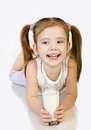 Cute little girl is drinking milk isolated Stock Photos