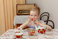 Cute little girl drinking tea at the old table. Royalty Free Stock Photo