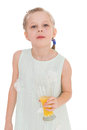 Cute little girl drinks orange juice isolated over white Royalty Free Stock Image
