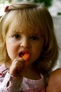 Cute little girl eating Royalty Free Stock Photo